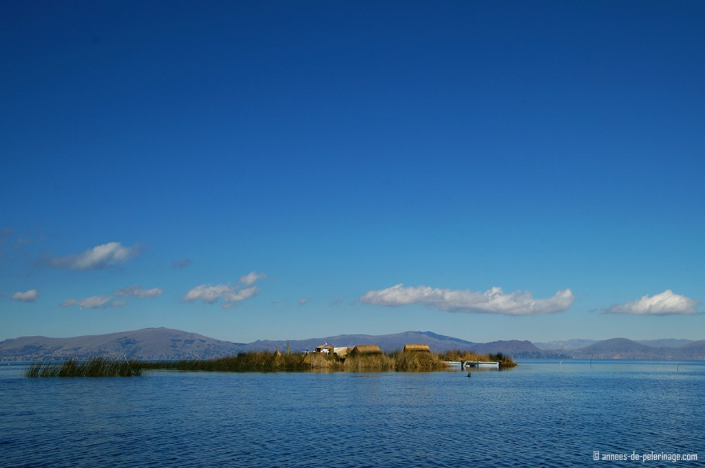 A small floating reed island of the Uros people on Lake Titicaca