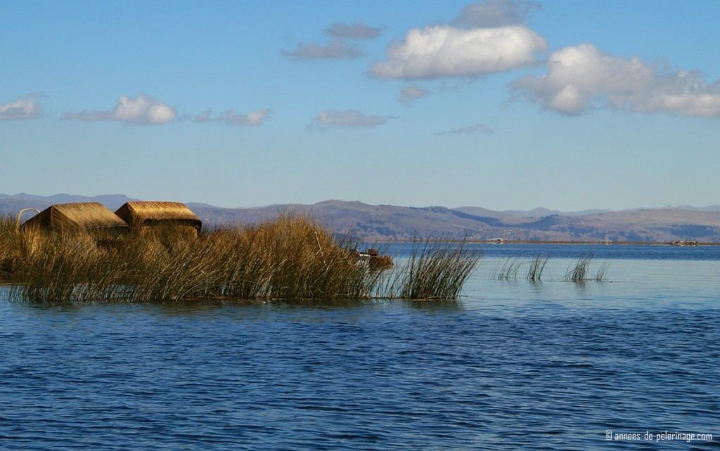 The floating totora reed islands of the Uros people on Lake Titicaca, Peru in warm light