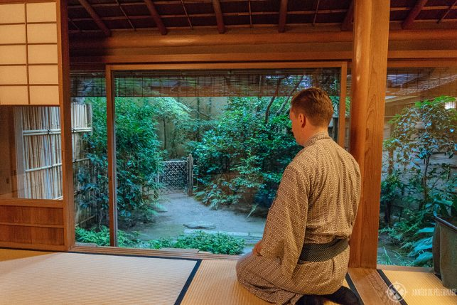 Me, wearing a yukata in a Ryokan in Kyoto - if you are wondering what to wear in Japan, then you really don't need to worry. Yukatas are provided for free in most hotels