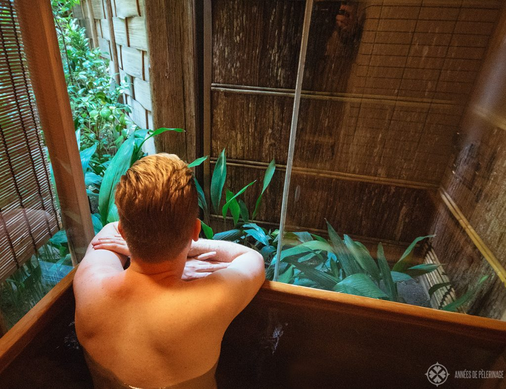 Enjoying the view of the zen garden from the bathtub of the tawaraya ryokan in Kyoto, Japan