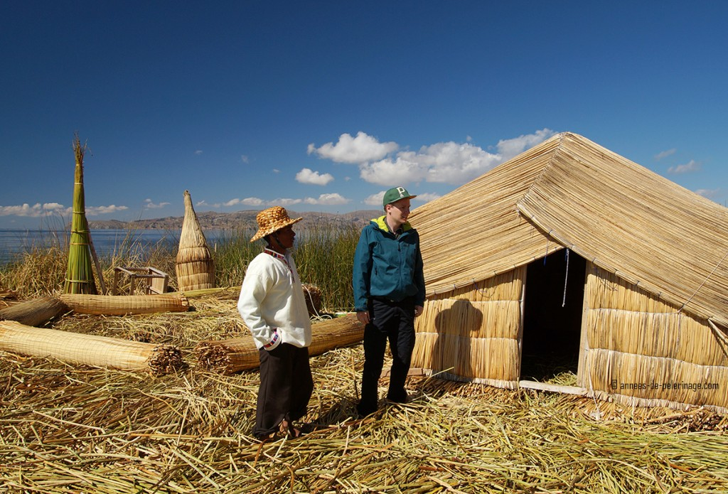 Me standing in front of the reed hut i will be sleeping tonight on the floating islands of the uros on lake titicaca