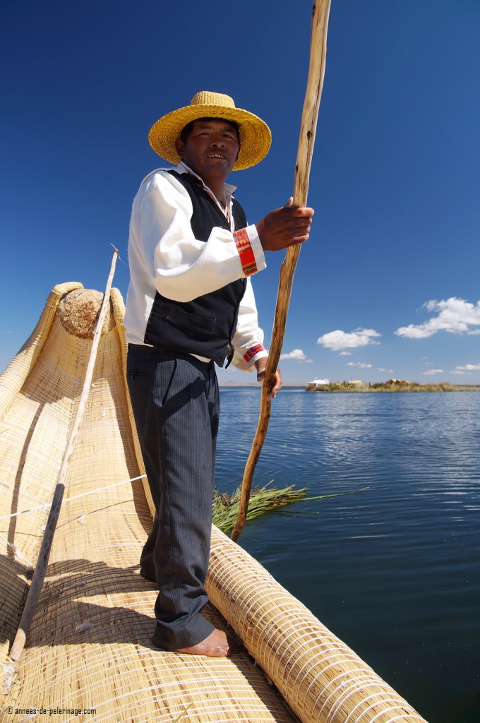 John steering a reed boat of the Uros people with freshly cut totora trailing behind