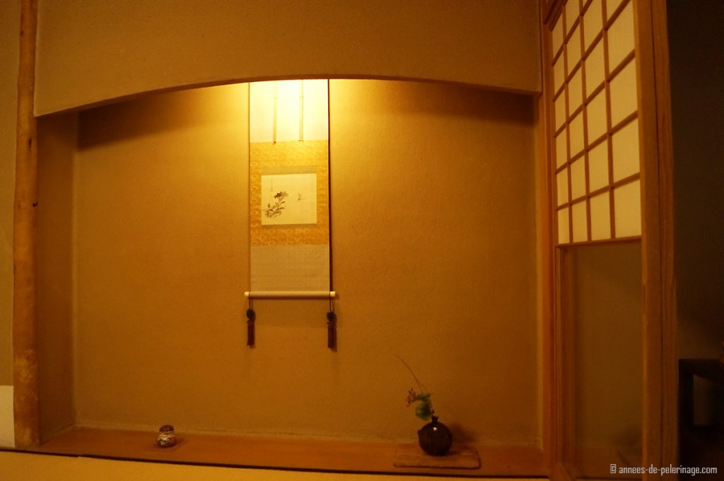 The tokonoma alcove at tawaraya ryokan with hanging scroll ikebana and pottery art