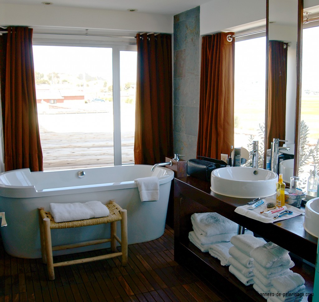 bathroom with huge bath tub and beautiful view at titilaka luxury lodge peru