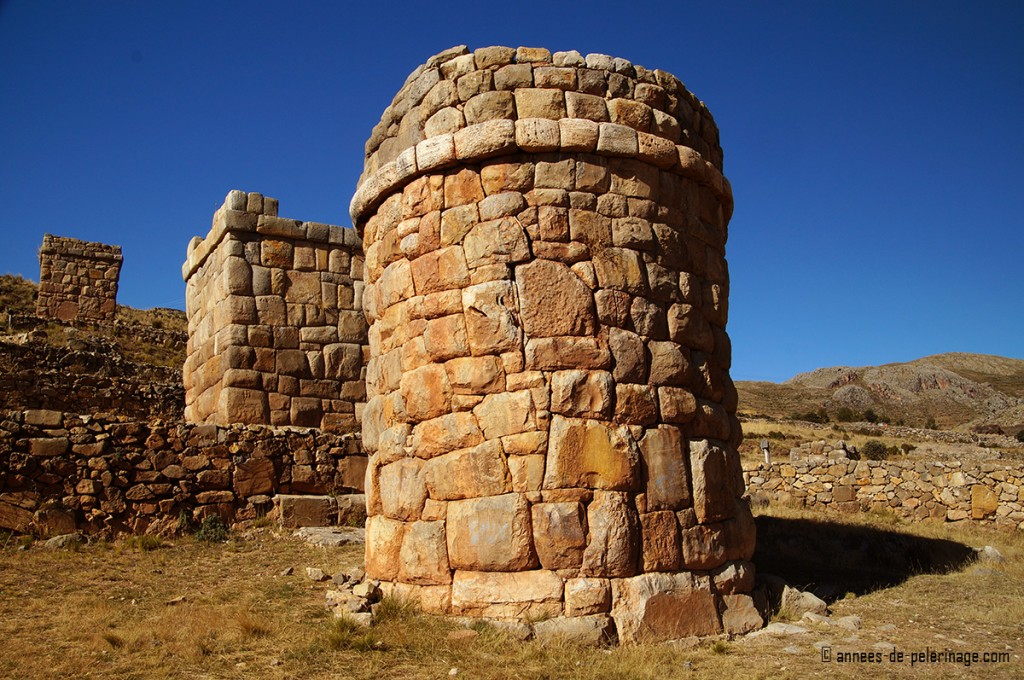 Chullpas, the funerary towers of the aymara people, here alligned neatly in a row upon a hill near puno peru