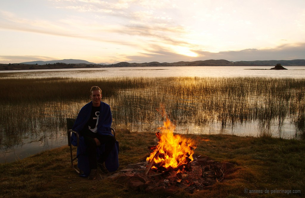 enjoying an open fire and the sunset on lake titicaca together with the staff of the Titilaka lodge