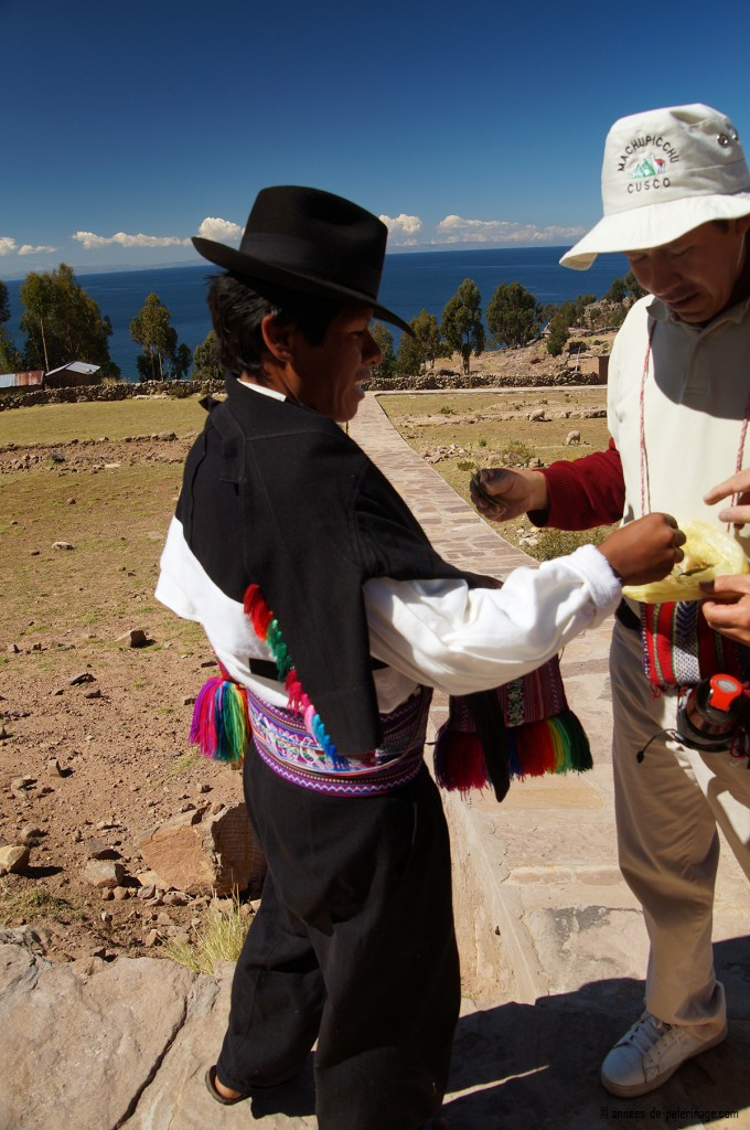 My guide exchanging coca leafs with the head of the community on taquile island lake titicaca.