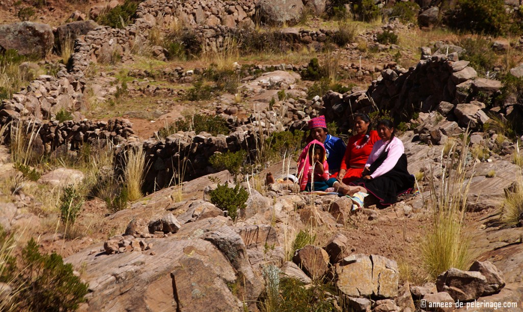 Farmers resting after a morning full of work on taquile island lake titicaca peru