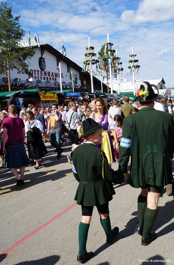 Locals strolling over oktoberfest in munich in dark green colors