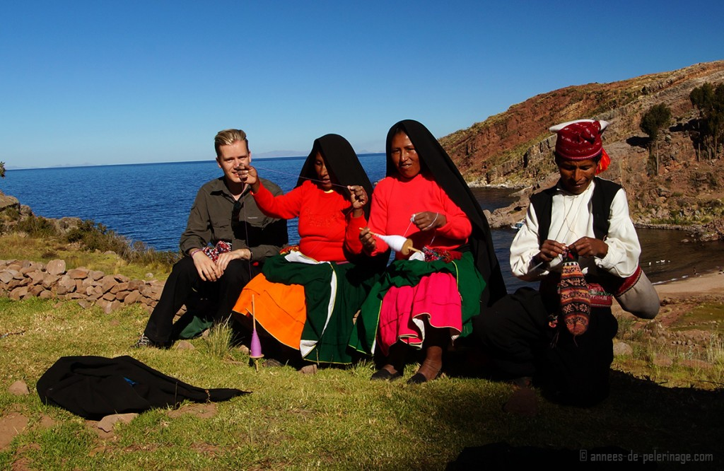 Me sitting with a the knitters and weavers of taquile islands, lake titicaca, peru
