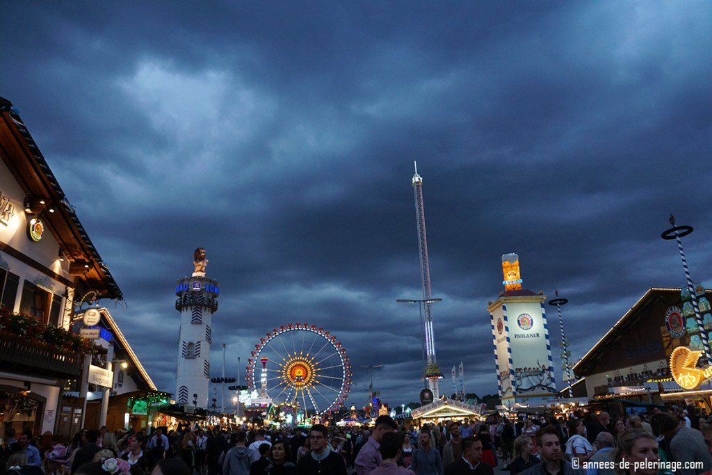 Oktoberfest in Munich at night is brightly lit with thousands of lights