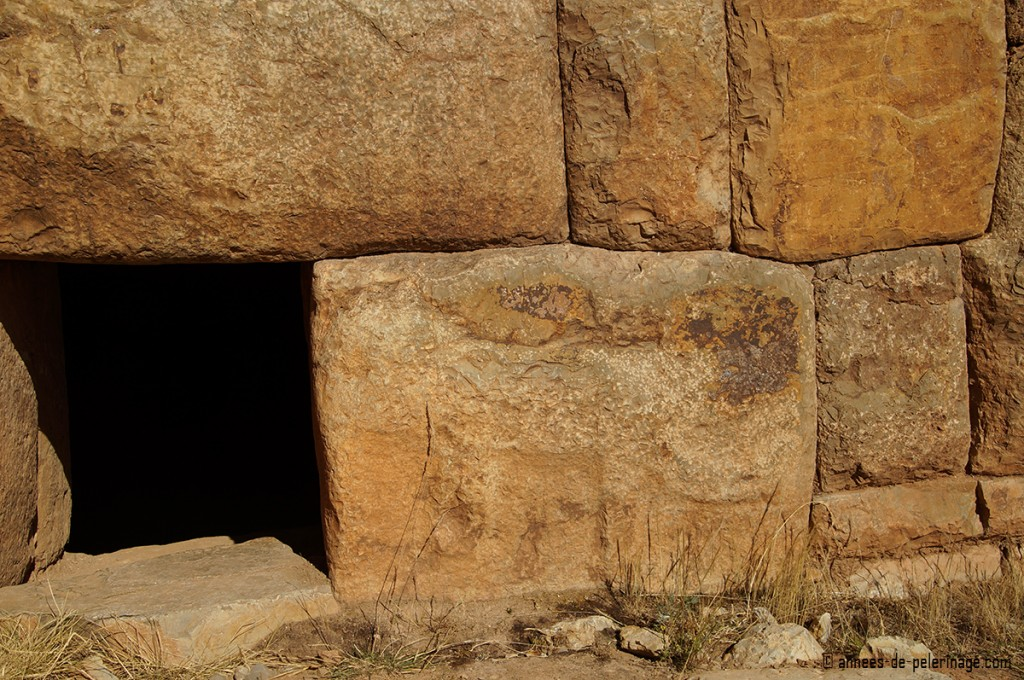 Opening door into the inner chamber of a chullpa facing east lake titicaca peru