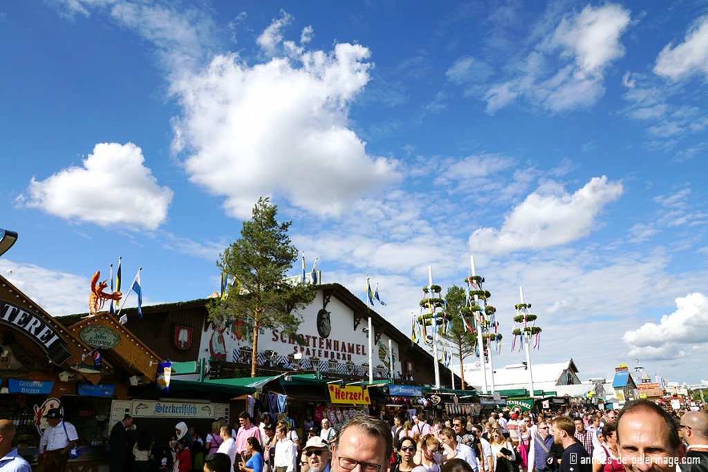 The schottenhammel beer tent on an especially sunny day at Oktoberfest in Munich