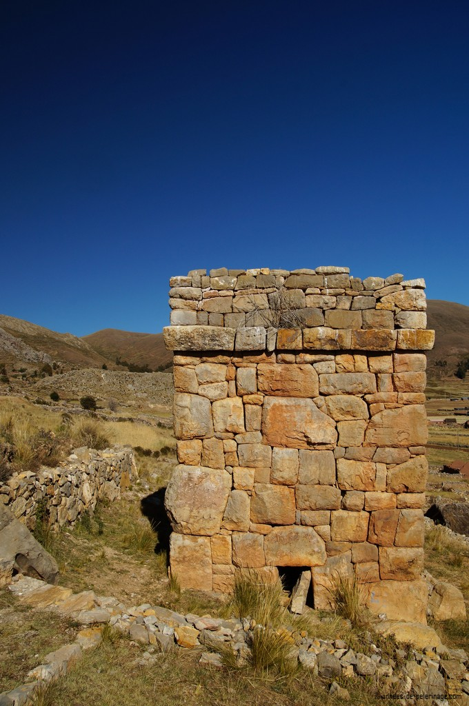 An ancient square funerary tower of the aymara people in puno, peru
