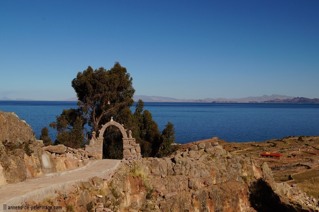 A stone arch marking the end of a community on taquile islands lake titicaca, peru
