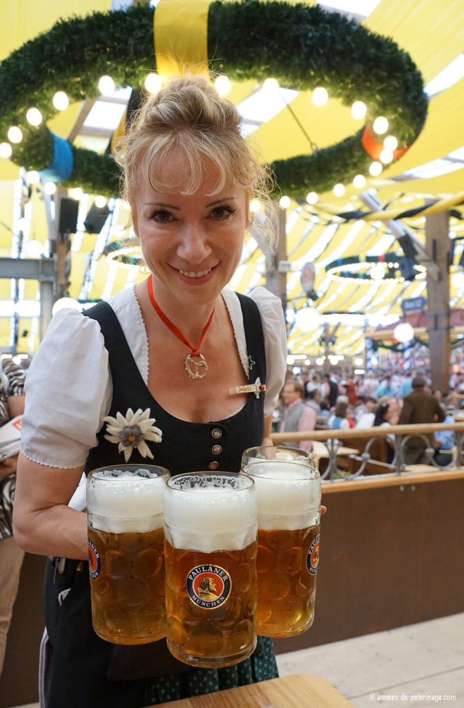 A waitress at paulaner zelt carrying full beer mugs