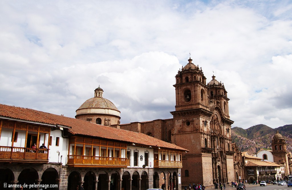The Plaza de Armas in Cusco Peru with its many balconies and arcades is your best thing to do in Cusco