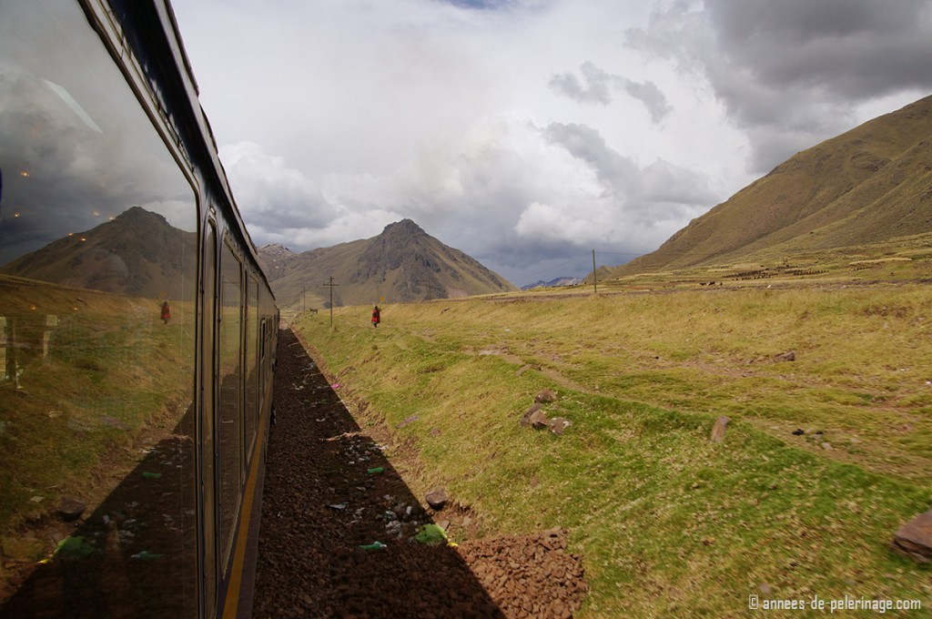The view along the Andean Explorer and a single woman walking along the altiplano in Peru