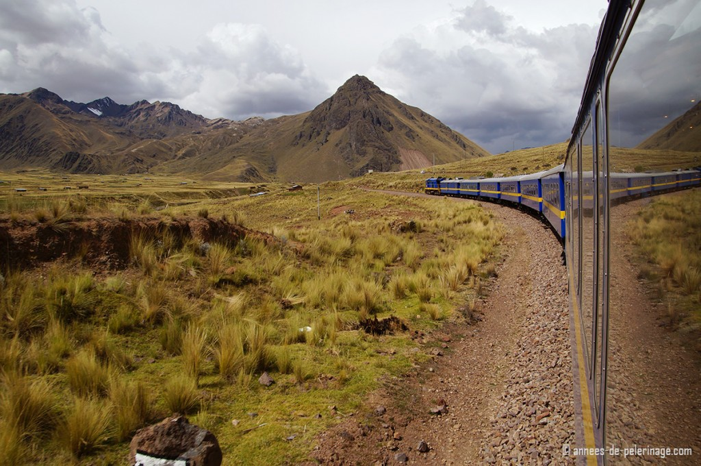 The Peru Rail Andean Explorer with high mountains behind it