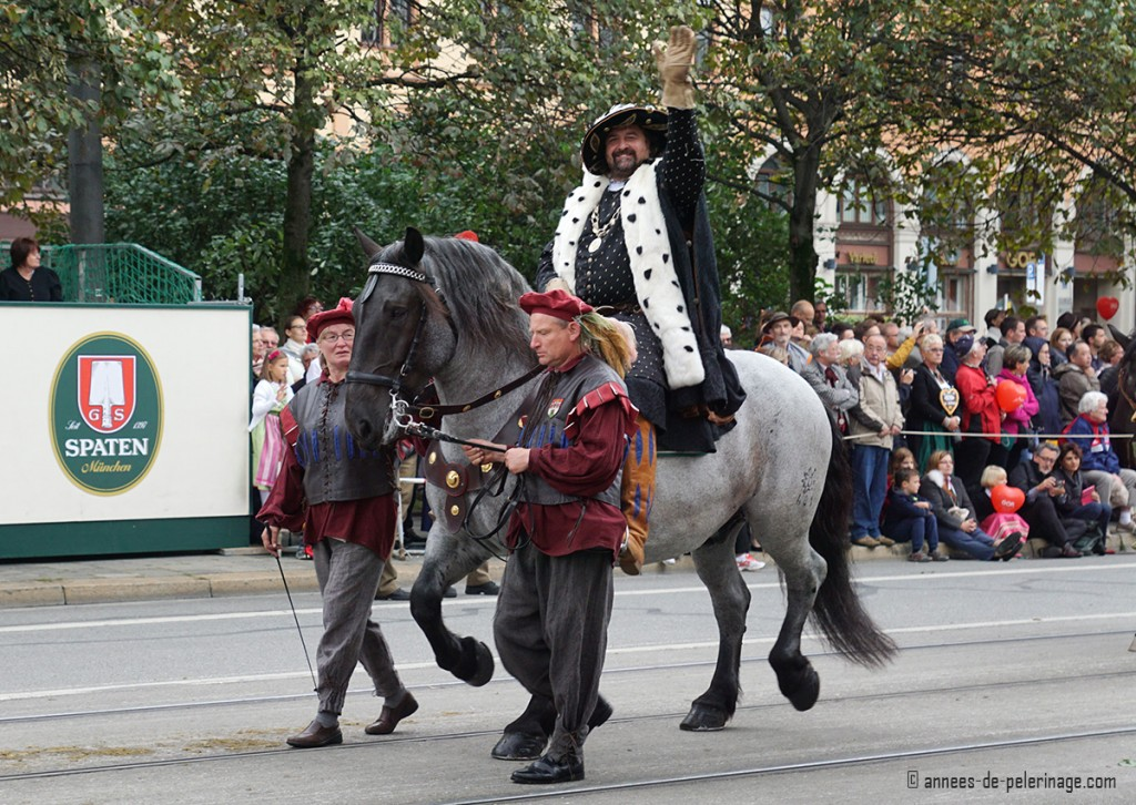 An actor dressed like a bavarian king at the traditional costume parade in munich