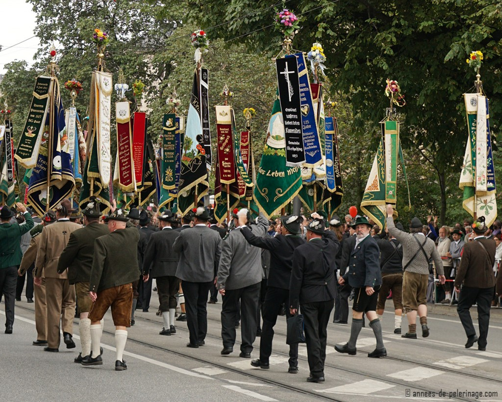Color guards holding their embroidered flags high at the oktoberfest costumes parade in munich