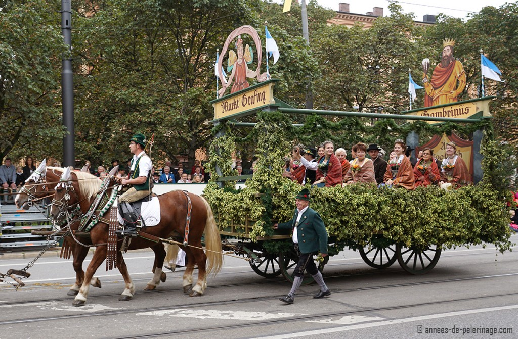 A festival float with young girls for the costume parade in munich