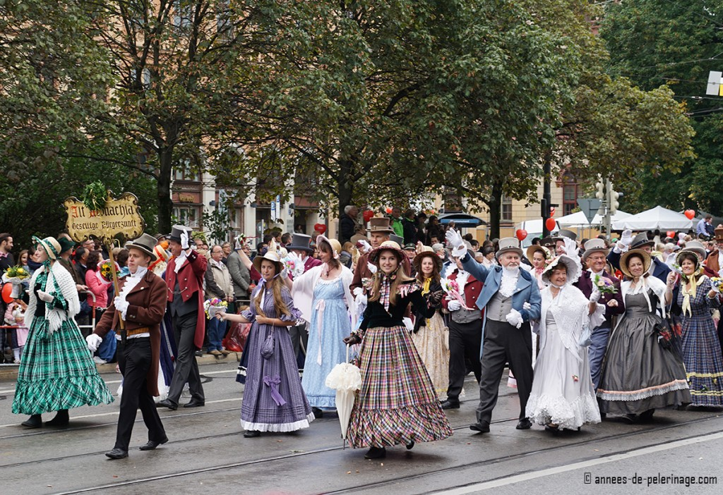Girls dressed in old dresses from the 18th century at the oktoberfest costume parade