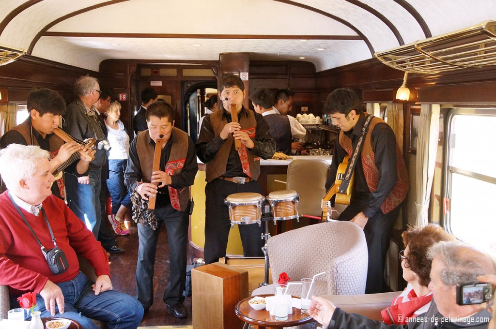 An inca band performing on the Andean Explorer in the bar wagon