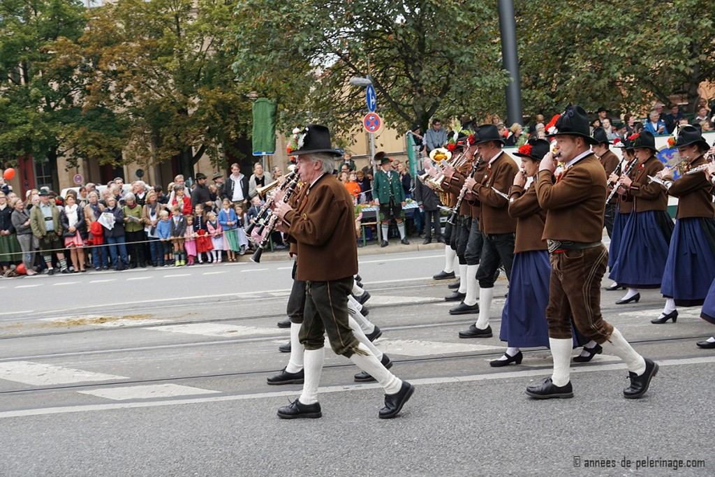 A marching band in traditional cloths at the oktoberfest parade in munich