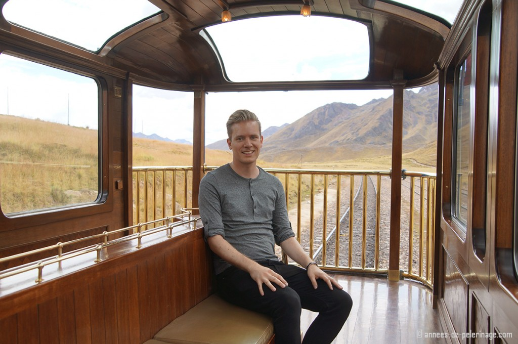 Me sitting on the luxury train by peru rail, called Andean Explorer, on the last wagon, ie the observation deck
