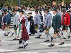 bavarian men and women in their traditional costumes for oktoberfest parade in munich