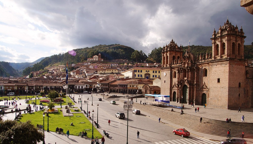 The beautiful Plaza de Armas bathed in golden sunlight in Cusco, Peru