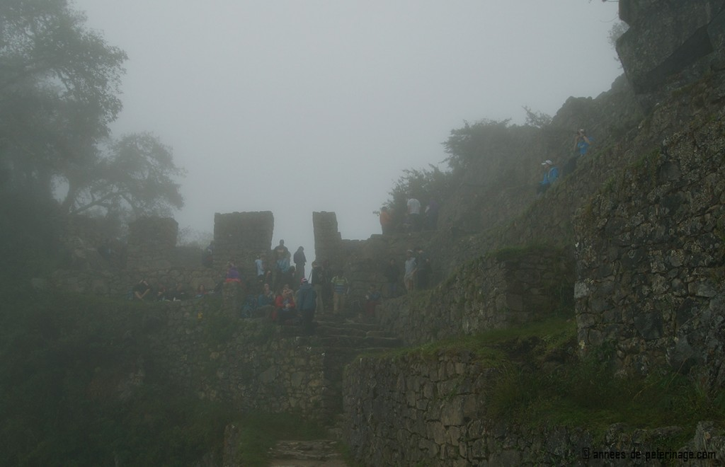 Machu Picchu facts: The sun gate over looking Machu Picchu is frequently hidden behind heavy fog