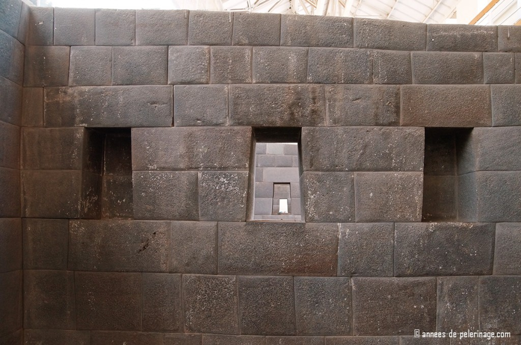 Things to do in Cusco: visit the temple of the sun in Cusco, Peru, with multiple windows perfectly aligned.