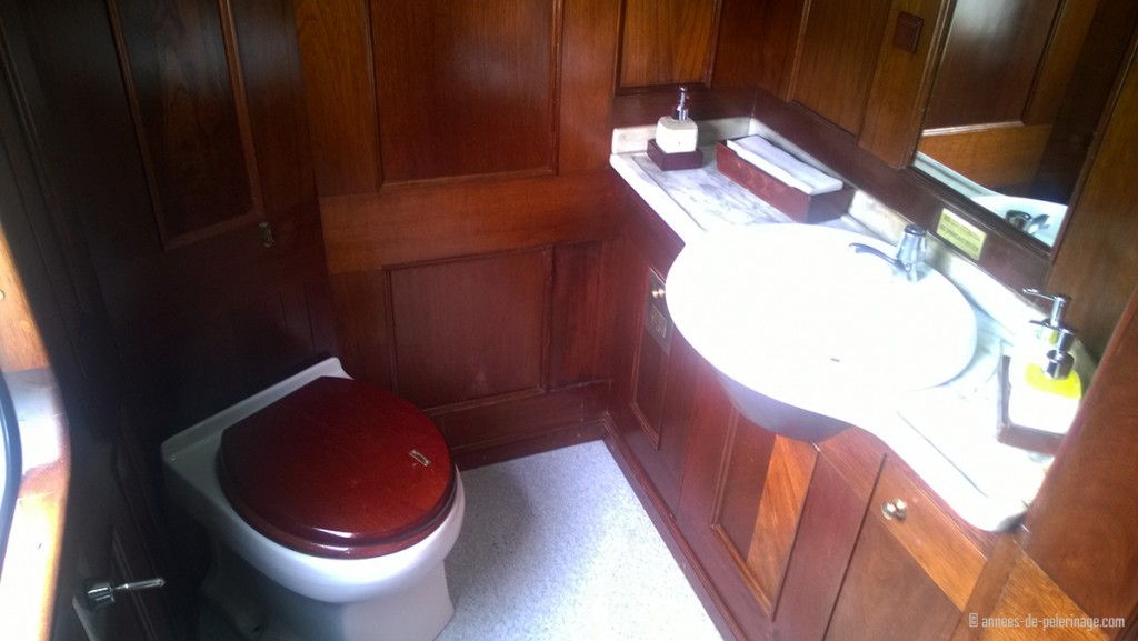The toiletts onboard the Andean Explorer luxury train with wooden panels and spa products