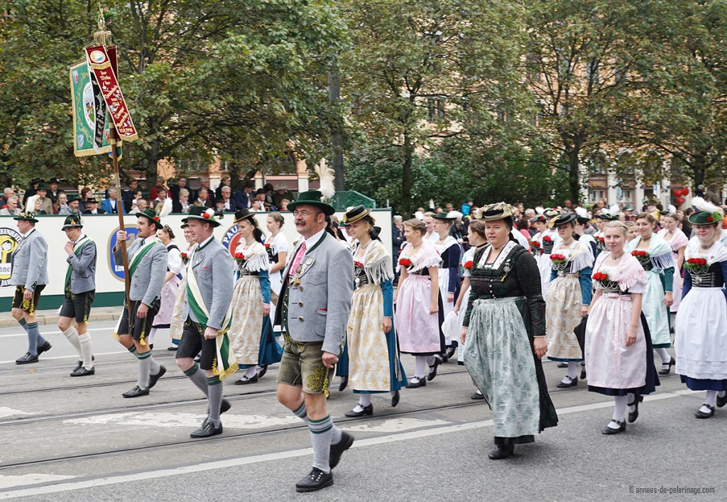 A group of men and women wearing traditional bavarian costumes at a parade for Oktoberfest, Munich