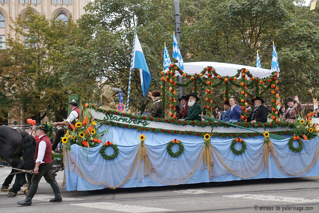 A traditional float in the shape of a rowing boad at the costume parade for Oktoberfest, munich