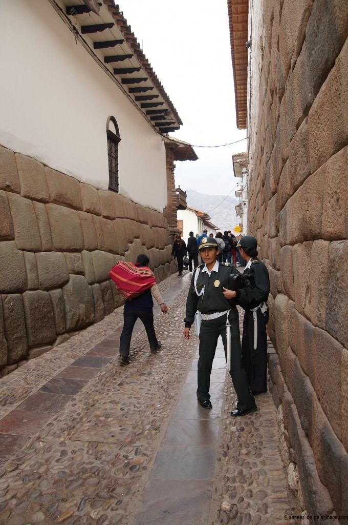 The small street witht he twelve angled stone and ancient inca foundations in cusco peru