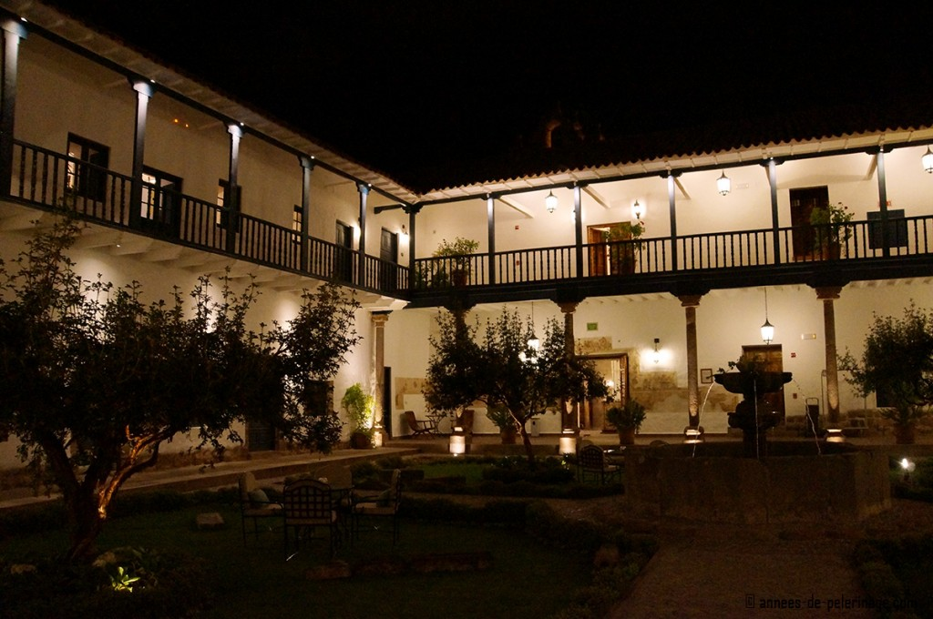 A courtyard ot the Belmond Palacio Nazarenas boutique hotel in Cusco at night