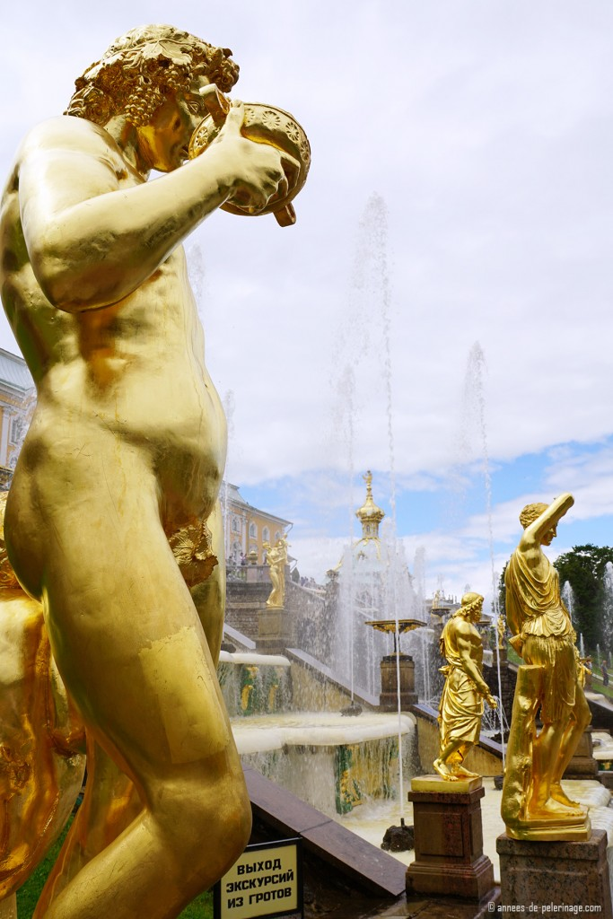 The golden roman statues of the grand cascade of Peterhof Palace in St. Petersburg, Russia
