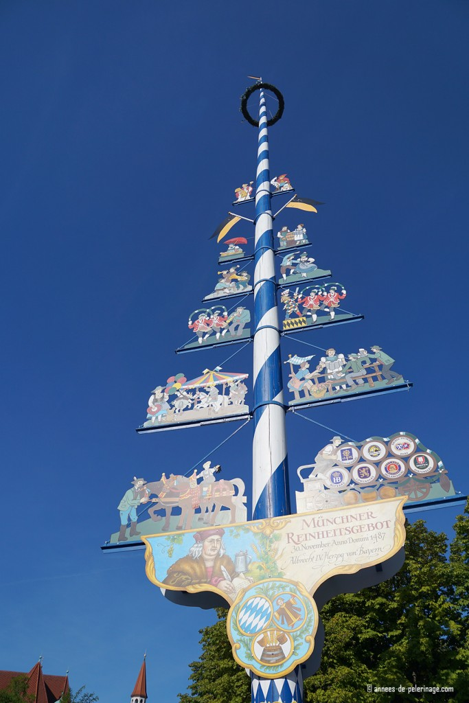 The may pole (Maibaum) standing in the middle of the Viktualienmarkt in Munich