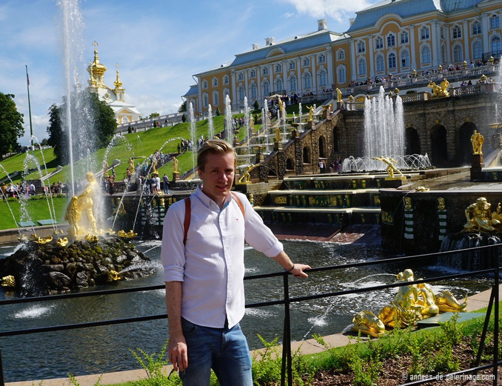 Me standing in front of the grand cascade of Peterhof Palace in St. Petersburg, Russia