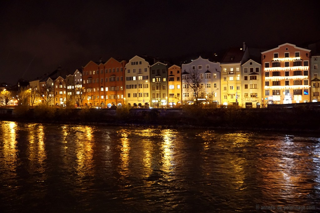 Colorful old houses lining the banks of river Inn in Innsbruck in Winter