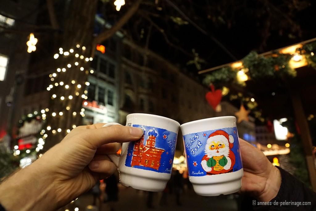 Drinking gluehwein (mulled wine) on the Christmas market in Munich