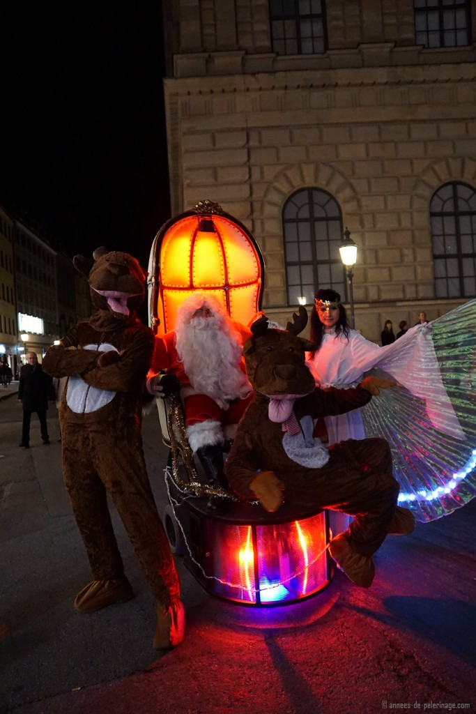 A performace of Santa Clause, two reindeers and an angel on the Christmas market in Munich