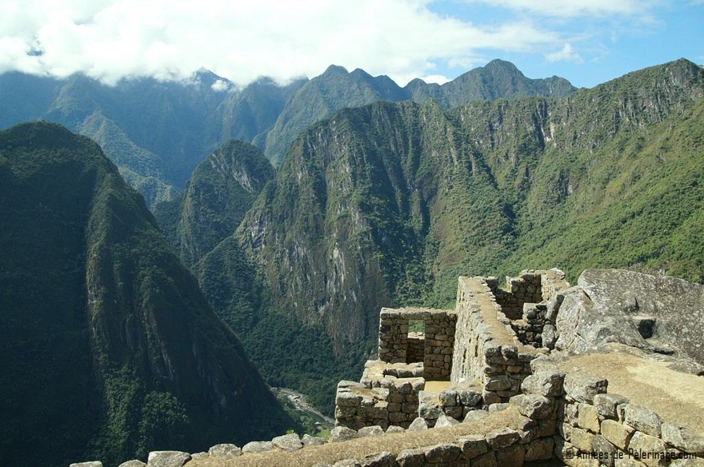 The so called prison of Machu Picchu with parts of the temple of the Condors to the right