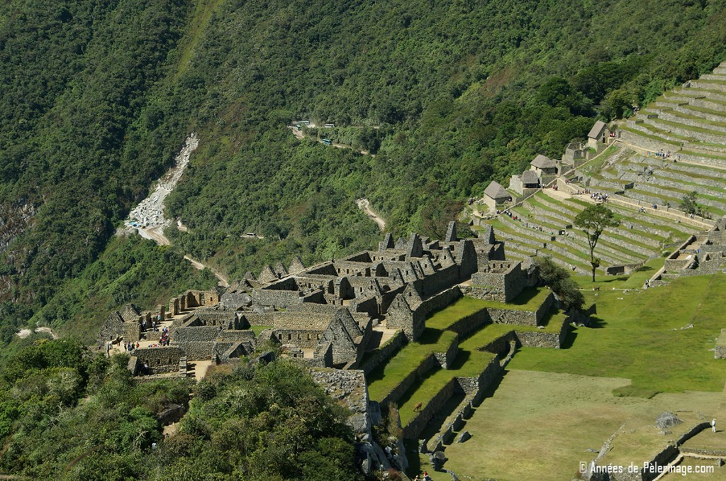 The houses of the industrial sector of Machu Picchu (agricultural sector behind it)