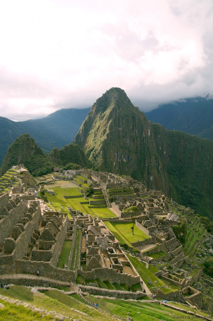 The classic view of Machu Picchu. The moat of the city clearly visible the foreground
