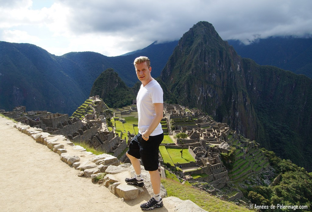 Me and the classic panorama of Machu Picchu. If you are wondering what to pack for peru - think in layers and start at the bottom. On a hot day shorts are perfectly fine in Machu Picchu