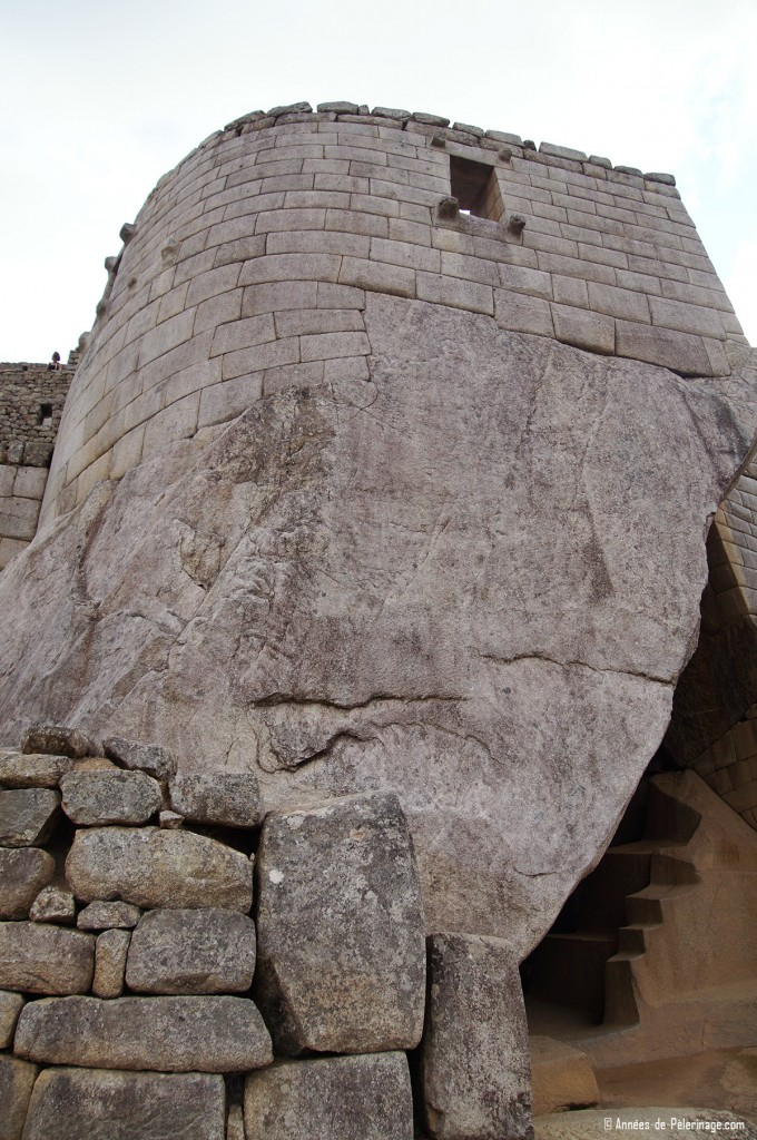 The temple of the Sun inside Machu Picchu with the royal tomb visible below